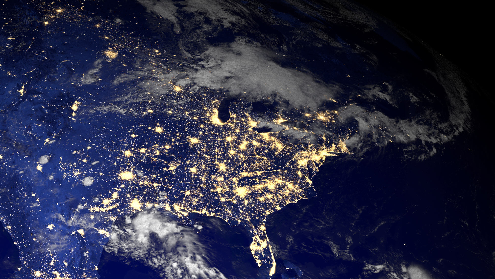 Outer space shot of America with city lights.
